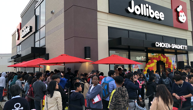 Thousands line up outside the new store on opening day, September 6.